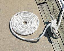 Free Coil Of Nautical Rope On Quayside Stock Photos - 86227273