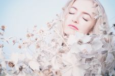 Free Blond Woman Surrounded By Flowers Stock Photos - 86227993