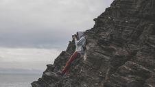 Free Man Taking A Photo Using Dslr Camera On Edge Of Mountain Under Gray Sky Royalty Free Stock Images - 86228279