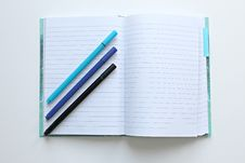 Free Lined Notebook Open With Three Pens Stock Image - 86228301