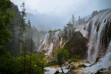 Free Waterfalls In Yellow Rocks Under White Foggy Sky Stock Photography - 86228962
