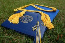 Free Graduation Mortarboard Cap On Grass Stock Photos - 86230673