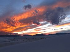 Free Sunset Skies Over Snowy Landscape Royalty Free Stock Photos - 86249838