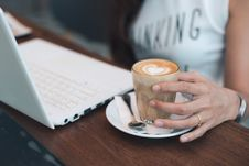 Free Close-up Of Woman Holding Coffee Cup On Table Royalty Free Stock Image - 86251066