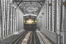 Free Green Train Coming Forward On White Metal Frame Royalty Free Stock Images - 86255039