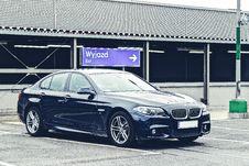 Free BMW Sedan In Parking Lot Royalty Free Stock Image - 86258566