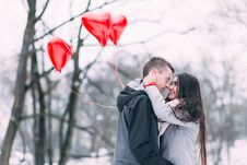 Free Two People With Heart Shape Balloons In Winter Royalty Free Stock Images - 86283439