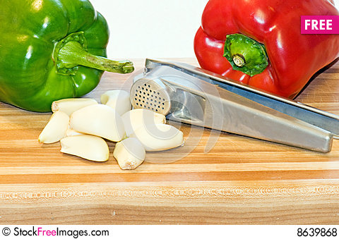 Free Peppers, Garlic Cloves And Press Royalty Free Stock Photos - 8639868