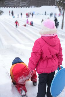 Free Children On Ice Slope In Park Stock Photo - 8632230