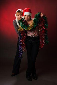 Free Two Woman Wearing A Santa Hat Stock Image - 8634151