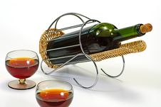 Wine Bottle In Basket Stock Photo