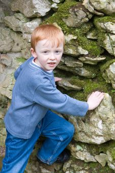Free Boy Starting To Climb Old Brick Wall Royalty Free Stock Image - 8637146
