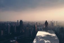 Free Man On Rooftop Royalty Free Stock Photo - 86311825