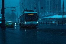 Free Tram On City Streets In Rain Royalty Free Stock Photos - 86312148