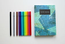 Free Notebook And Colored Pens Royalty Free Stock Image - 86312516
