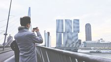 Free Rear View Of Man Photographing Cityscape Royalty Free Stock Photo - 86314135