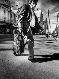 Free Man In Formal Coat Carrying Plastic Bag Royalty Free Stock Photo - 86352255