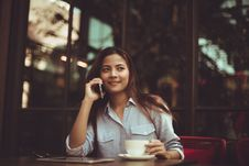 Free Portrait Of Young Woman Using Mobile Phone In Cafe Stock Photos - 86353603
