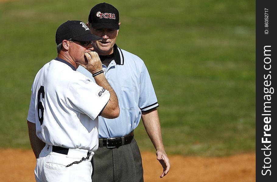 Baseball player and umpire