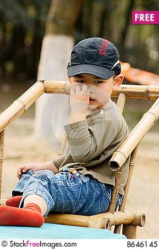 Free Boy Picking Nose Royalty Free Stock Photo - 8646145