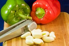 Peppers, Garlic Cloves And Press Royalty Free Stock Photo