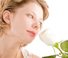 Free Portrait Of Attractive Blond Girl Smelling Rose Royalty Free Stock Photography - 8640787