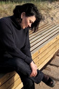 Free Woman Resting On The Seat Next To The Sandy Beach Stock Image - 8641751