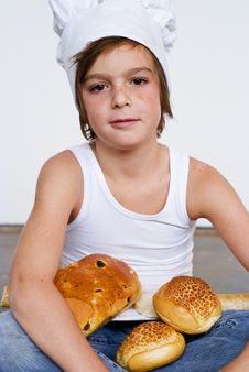 Free Young Baker Boy And Bread Royalty Free Stock Photo - 8641945