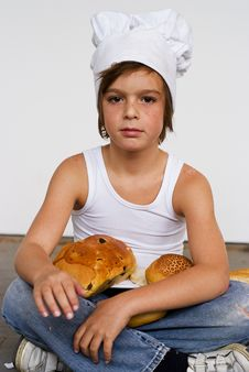 Free Young Baker Boy And Bread Royalty Free Stock Images - 8641959