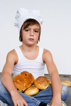 Free Young Baker Boy And Bread Royalty Free Stock Photography - 8642037