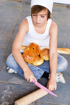 Free Young Baker Boy And Bread Stock Photography - 8642052