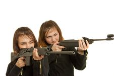 Two Gils With Guns Stock Photo