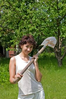 Girl With Spade Stock Photo