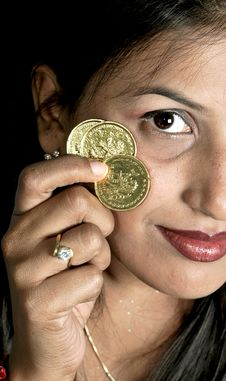 Girl With Coins Stock Photo