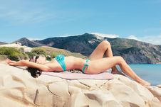Free Woman Lying On Rocks At The Beach Royalty Free Stock Photo - 86473215