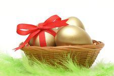 Golden Eggs In Basket Stock Photography