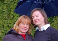Free Mother And Adult Daughter Under Umbrella Stock Photos - 8655963