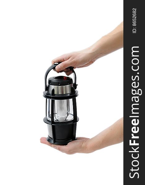 Portable lamp in man hands