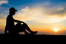 Free Silhouette Of A Man Sitting Near The Ocean Royalty Free Stock Photos - 86543408