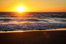 Free Sunset Over Sandy Beach Stock Photo - 86574630