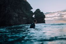 Free Swimmer Off Rocky Cliff Stock Image - 86575601