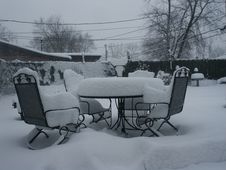 Free Snow Covered Patio Furniture Royalty Free Stock Image - 86575846