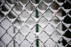 Free Black Cyclone Fence Covered With Snow Royalty Free Stock Images - 86576739