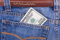 Free Hundred Dollar Bill In Pocket Of Blue Jeans Stock Photography - 8664602