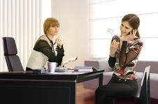 Businesswomen In The Office Stock Photos