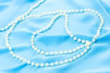 Blue Silk Texture And Pearls Royalty Free Stock Images