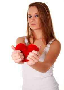 Woman And Artificial Red Heart Stock Photo