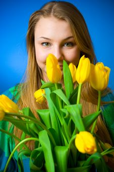 The Beautiful Girl With Tulips Royalty Free Stock Photography