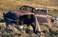 Old Rusty Abandoned Car In A Field Royalty Free Stock Image