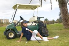 Pretty Golf Player With Her Golf Car Royalty Free Stock Photography
